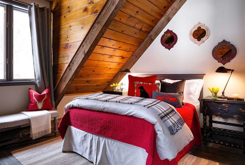 Cabaña de madera de estilo dormitorio de invitados con estallidos de rojo