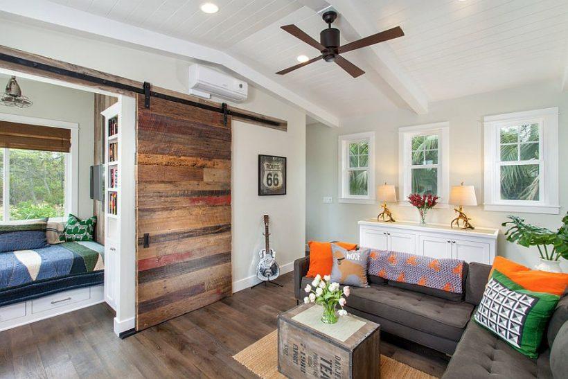 Ingeniosas salas de estar que muestran la belleza de las correderas puertas de granero