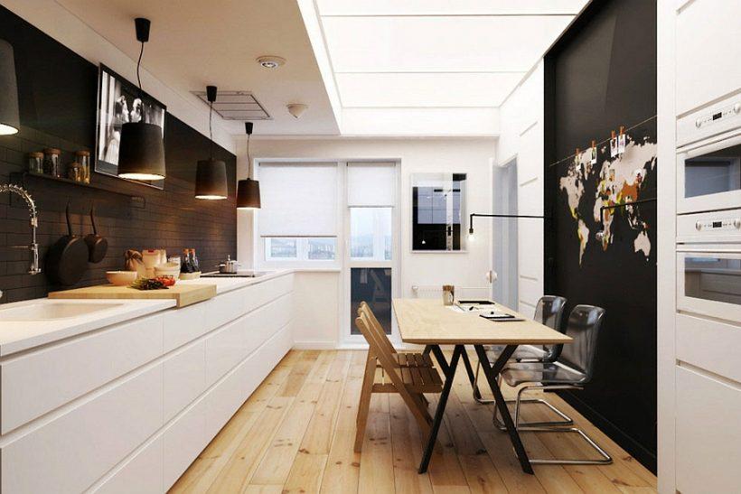 Grandes colgantes de color negro por encima de la encimera de la cocina